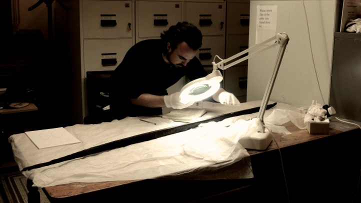 Examining the 10th Century Ballinderry Bow, at the National Museum of Ireland.