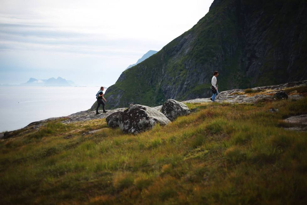 Espen and Laura wandering across the misty mountains of Å, Lofoten