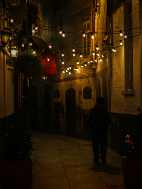 Someone stroll down an alley off Grafton Street - Christmas week