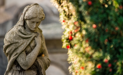 An odd statue in Mount St Jerome Cemetery, Dublin; I only noticed the medalion when editing the image later