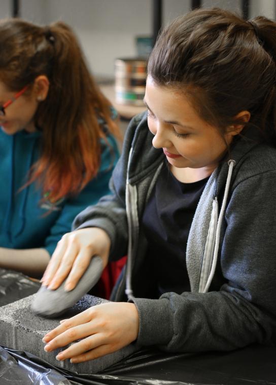Grinding an edge, to make a stone axe