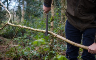 Trimming the sides of the Hazel Rods - To be used as wattle